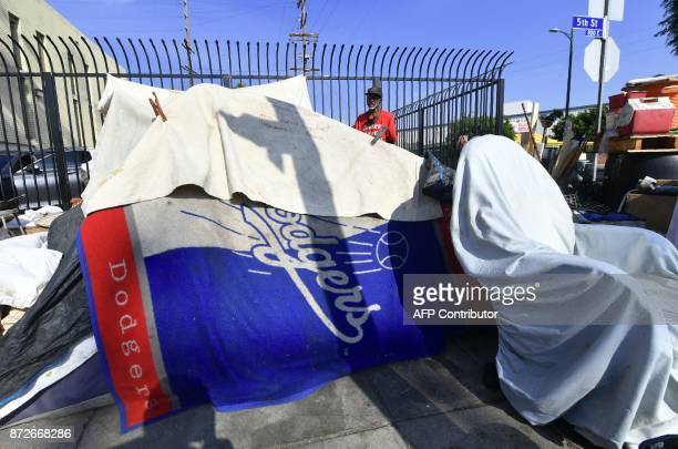 Homeless veteran Kendrick Bailey steps out of his street corner tent on November 10 2017 in Los Angeles California home to one of the nation's...