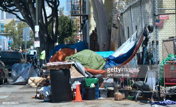 Homeless veteran Kendrick Bailey's tent stans on a streetcorner near Skid Row in downtown Los Angeles California on June 20 2017 After dropping some...