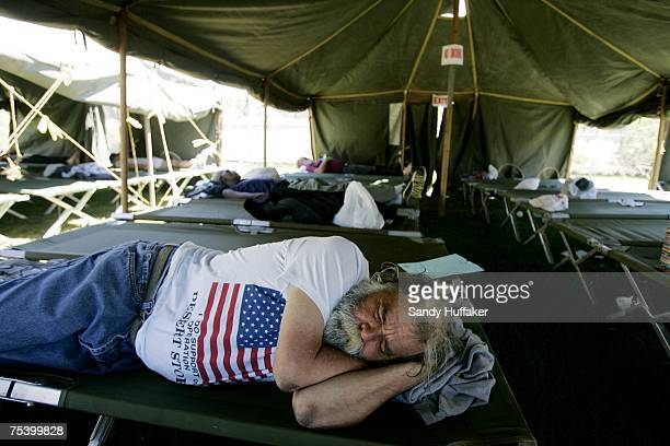 A homeless veteran sleeps in a tent during Stand Down 2007 on July 13 2007 in San Diego California Stand Down is a yearly event that primarily...