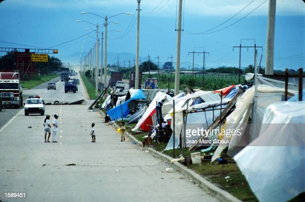 Homeless victims of Hurricane Mitch still live in makeshift shelters and shacks along the highway in El Progresso, Honduras, near San Pedro Sula...