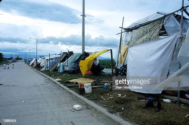 Homeless victims of Hurricane Mitch still live in makeshift shelters and shacks along the highway in El Progresso Honduras near San Pedro Sula...