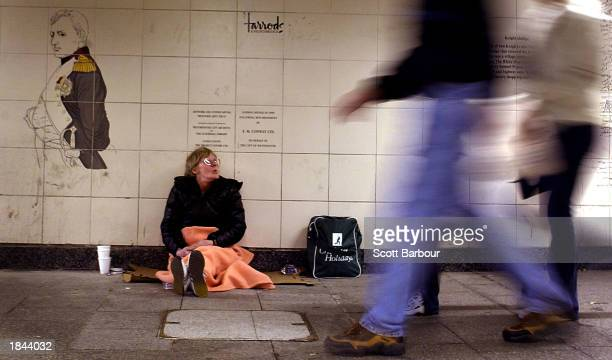 A homeless woman begs for change in a subway station March 12 2003 in London Homeless charities and human rights activists have balked at government...