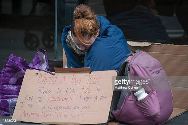CONTENT] A homeless woman crouching on the corner of the street in the afternoon resigned and begging for money on 23rd St in New York City This...