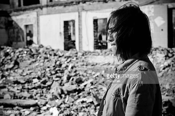 homeless woman crying - xlarge - house collapsing stock pictures, royalty-free photos & images