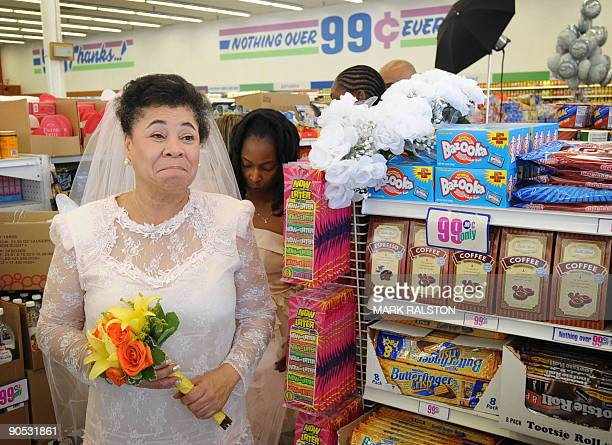 Homeless woman Gwen Whitmore waits for her 99 cent wedding ceremony at the 99 cent store in Los Angeles on September 9 2009 The budget supermarket...