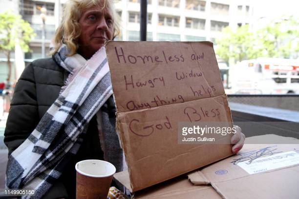 A homeless woman holds a sign as she begs for money on May 17 2019 in San Francisco California Results of a twoyear Homelessness PointinTime Count...