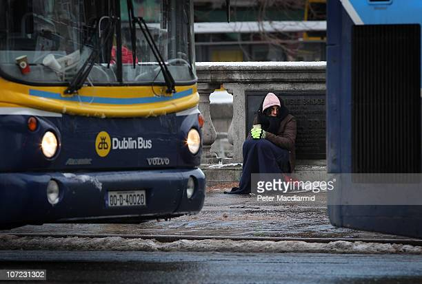 A homeless woman holds out a cup for money on The O'Connell Bridge on December 1 2010 in Dublin Ireland The Irish economy has faltered after years of...