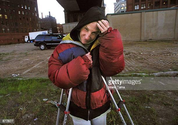 Homeless woman Joan Kimball stands beneath the Manhattan bridge where she lives November 20 2001 in the Brooklyn borough of New York City Economic...