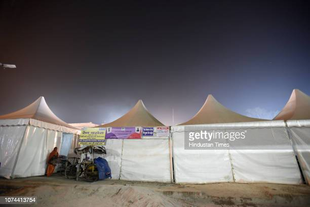 A homeless woman outside temporary shelter homes at Nizamuddin Basti on December 18 2018 in New Delhi India There are some 83 permanent shelters and...