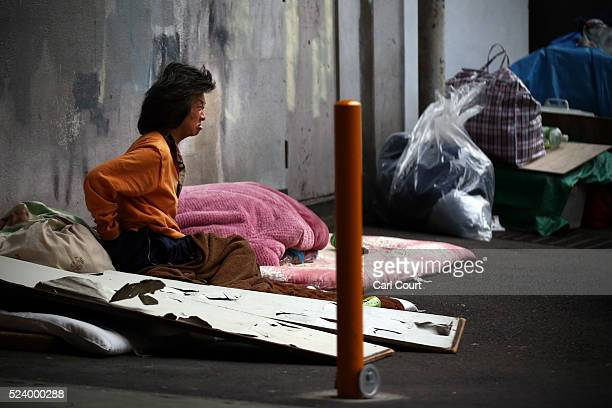 A homeless woman sits in the street in the slum area of Kamagasaki on April 23 2016 in Osaka Japan Kamagasaki a district in Japan's second largest...
