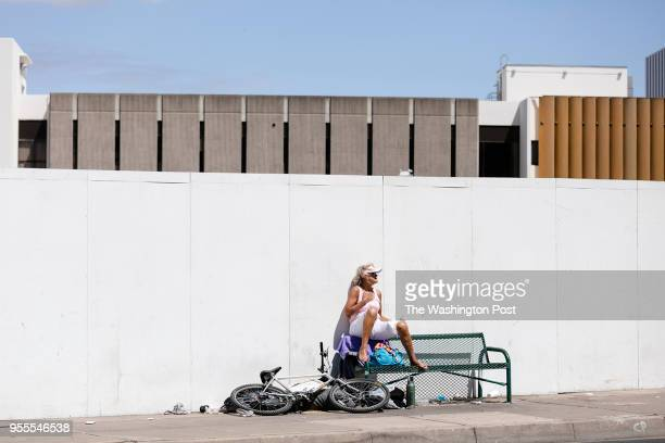 A homeless woman sits on a bench on Santa Ana Blvd in Santa Ana California on April 16 2018