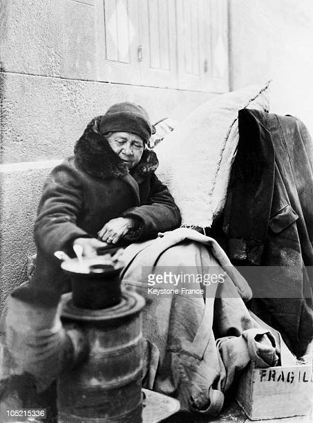 Homeless Woman Warms Food In A Street In Liverpool, Circa 1930-1939.