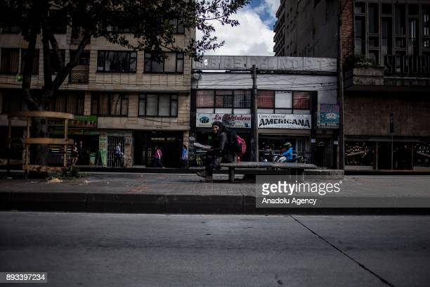 A homeless woman who has four children rests at the street in Bogota Colombia on December 15 2017 Homeless people eat their meal distributed by...