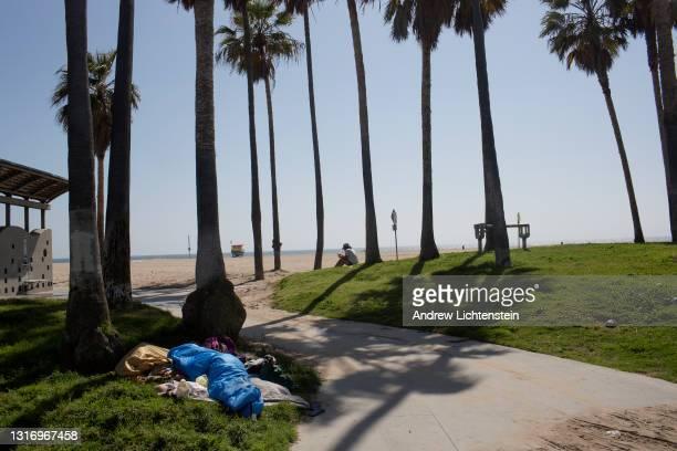 Homeless's belongings lie on the boardwalk on May 4, 2021 in Venice, California.