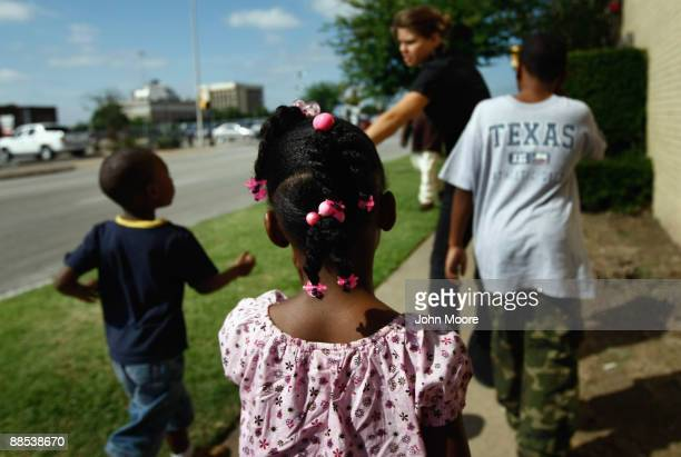 Homelesss children leave the Family Gateway shelter on June 17, 2009 in Dallas, Texas. More than 50 children live with their parents at the center,...