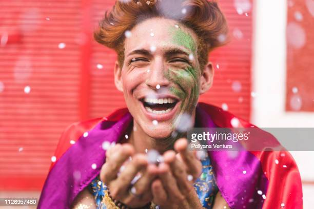 homem blow confetti from hands - brazilian carnival stock pictures, royalty-free photos & images