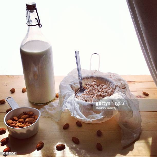 Homemade almond milk and ingredients