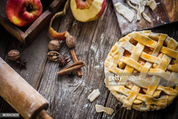 homemade apple pie on a wood surface - apple pie stock photos and pictures