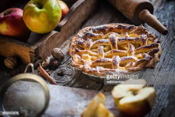 homemade apple pie on a wood surface - old fashioned thanksgiving stock photos and pictures