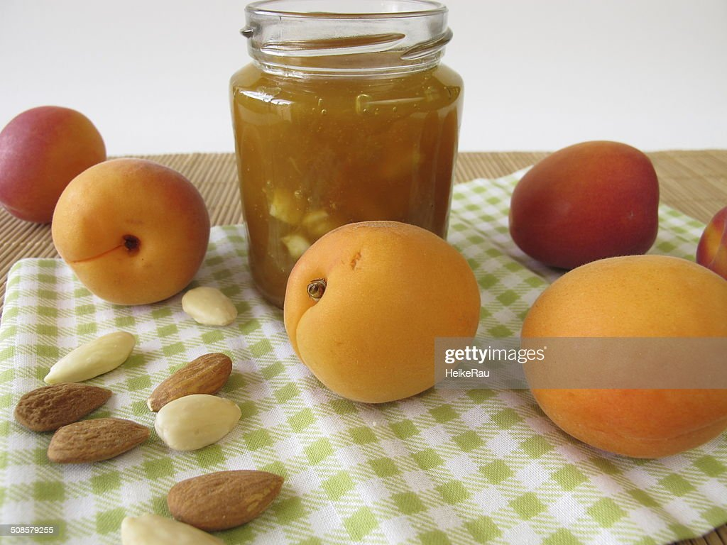 Homemade apricot jam with almonds : Stock Photo