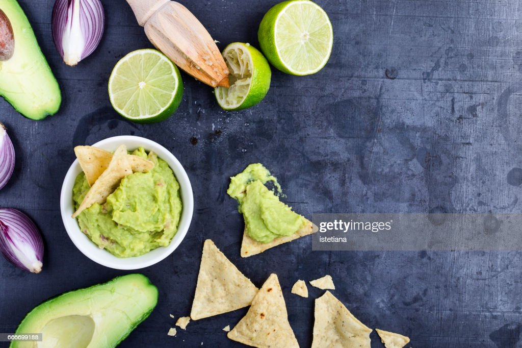 Homemade avocado guacamole dip with fresh ingredients on gark grey background with copy space : Stock Photo