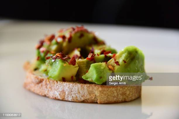homemade avocado on toast - healthy eating stock pictures, royalty-free photos & images