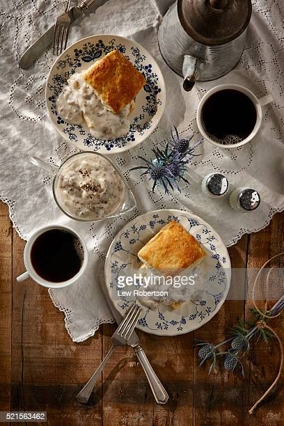 Homemade biscuits and gravy with coffee