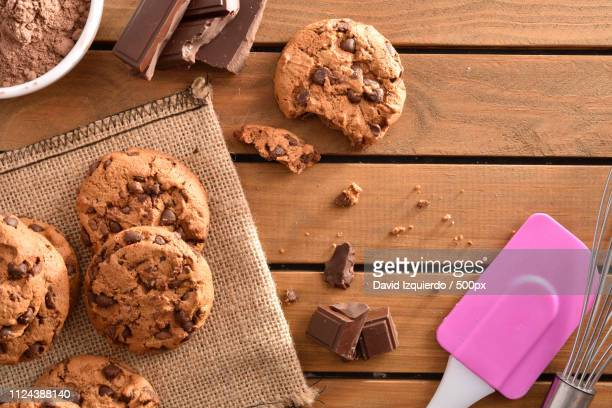 Homemade Biscuits With Chocolate Chips On Wooden Slatted Table T