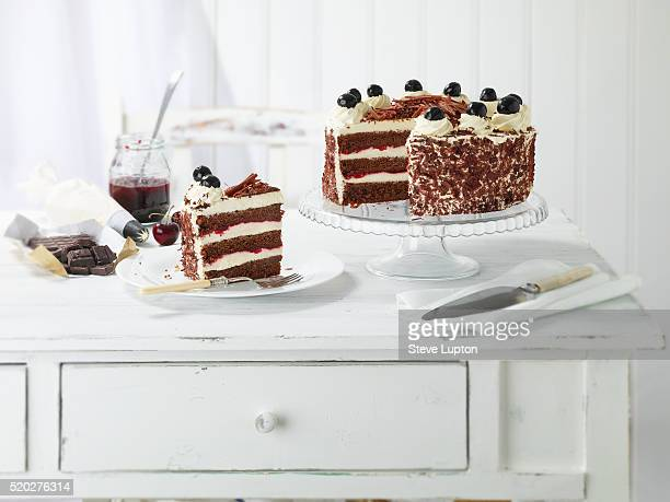 Homemade Black Forest Gateau with a slice on a plate