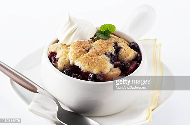 Homemade blueberry cobbler in a white bowl