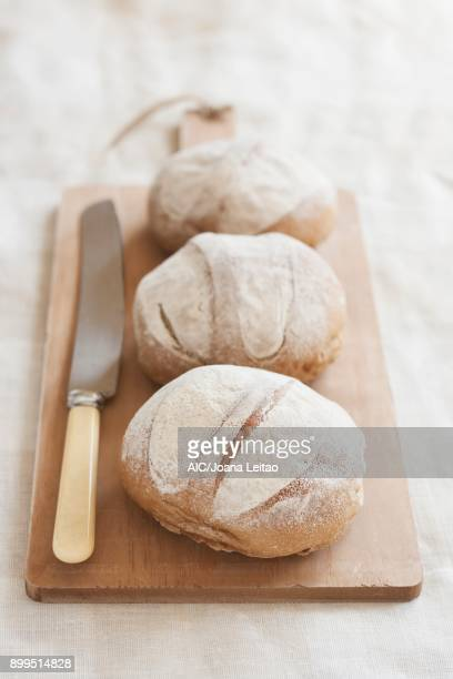 Homemade bread on a wooden board with an old bread knife