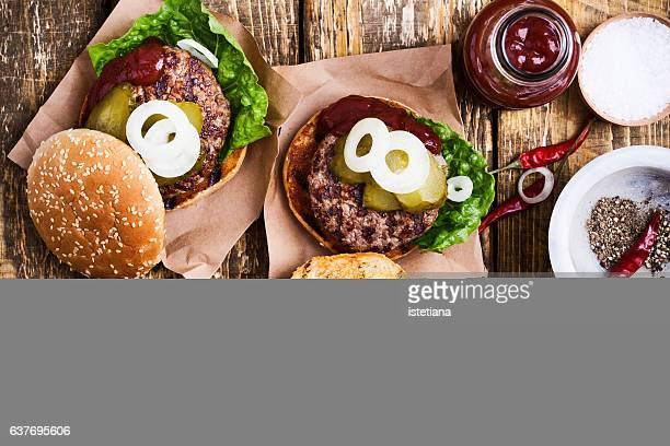 Homemade burgers with meat cutlet and pickles