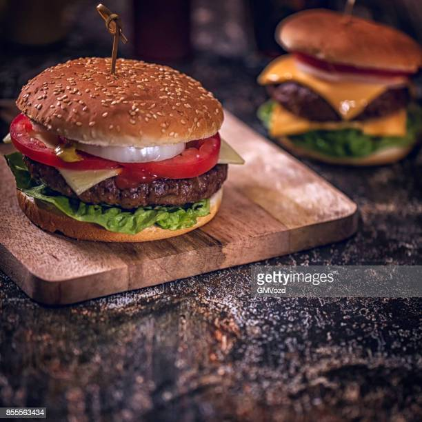 Homemade Burgers with Tomatoes, Onions and Salad