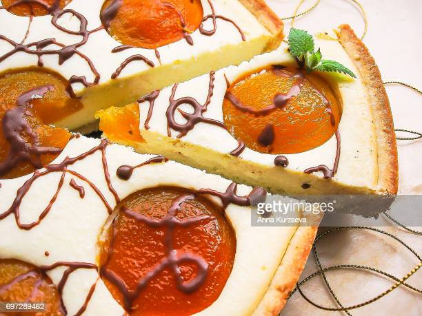 Homemade cake or pie with cottage cheese, peaches and chocolate, selective focus