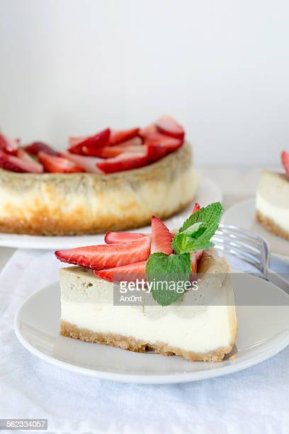 Homemade cheesecake decorated with strawberries