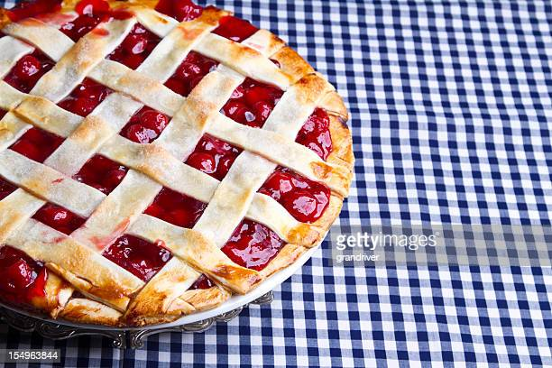 Homemade Cherry Pie on Blue Gingham Checked Tablecloth