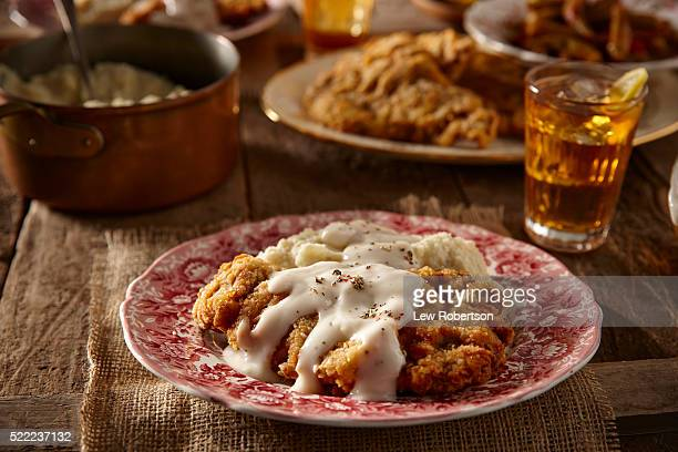 homemade chicken fried steak dinner - fried chicken stock pictures, royalty-free photos & images