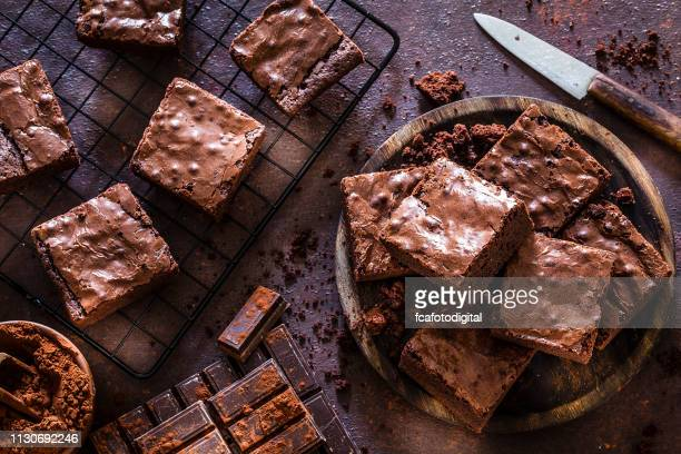 homemade chocolate brownies shot from above - dessert stock pictures, royalty-free photos & images