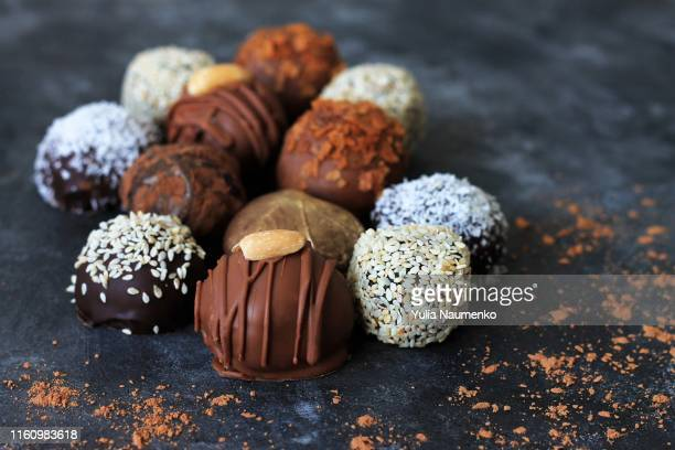 homemade chocolate candies for valentine's day on dark background. - sweet food stock pictures, royalty-free photos & images