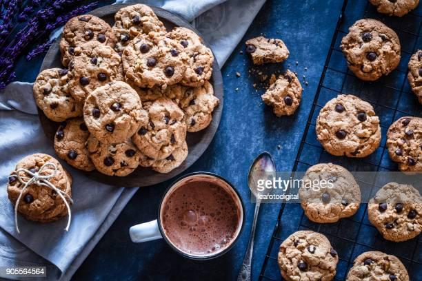 Homemade chocolate chip cookies and hot chocolate mug