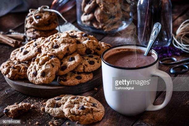 homemade chocolate chip cookies and hot chocolate mug - hot chocolate stock pictures, royalty-free photos & images