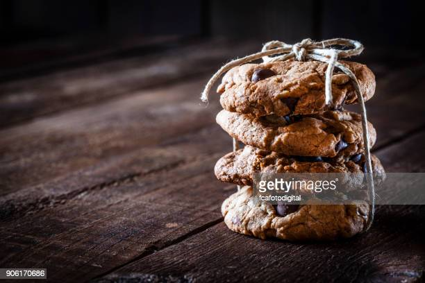 Homemade chocolate chip cookies on rustic wooden table