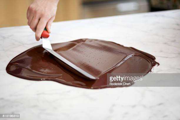 homemade chocolate making - chocolate making stock pictures, royalty-free photos & images