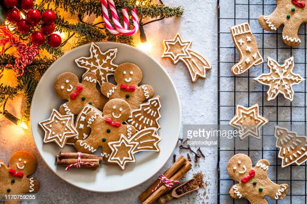 homemade christmas cookies on gray table - dessert stock pictures, royalty-free photos & images
