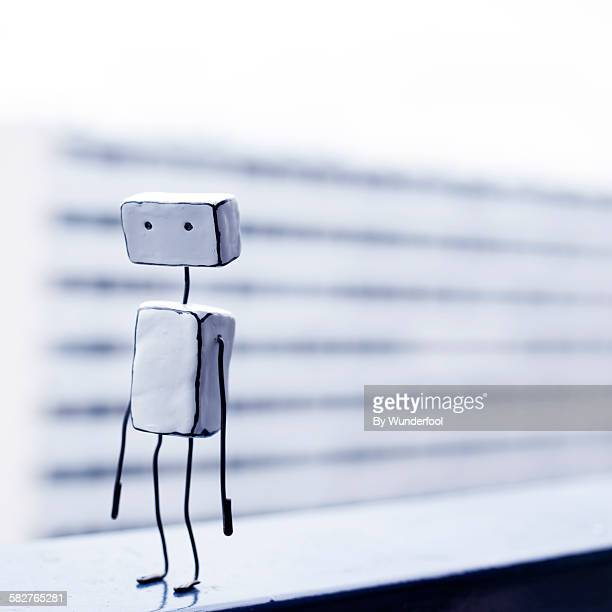 homemade clay robot figurine in an urban setting - vanguardians stock pictures, royalty-free photos & images