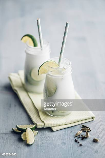Homemade coconut milk flavoured with syrup, cardamom and lime