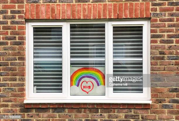 A homemade drawing of a rainbow for the NHS in a window on April 08 2020 in Aylesbury England There have been around 50000 reported cases of the...