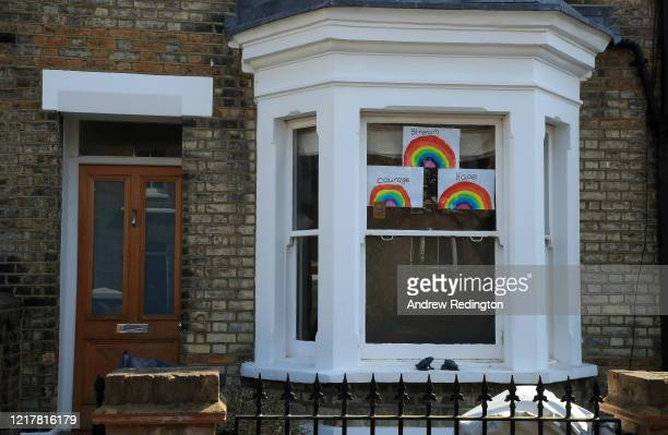 Homemade drawings of a rainbow for the NHS are pictured in a window on April 09 2020 in West Putney London England There have been around 60000...