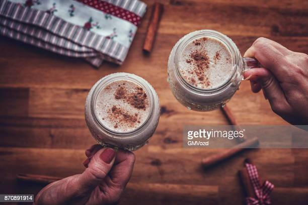homemade eggnog for christmas - eggnog stock photos and pictures