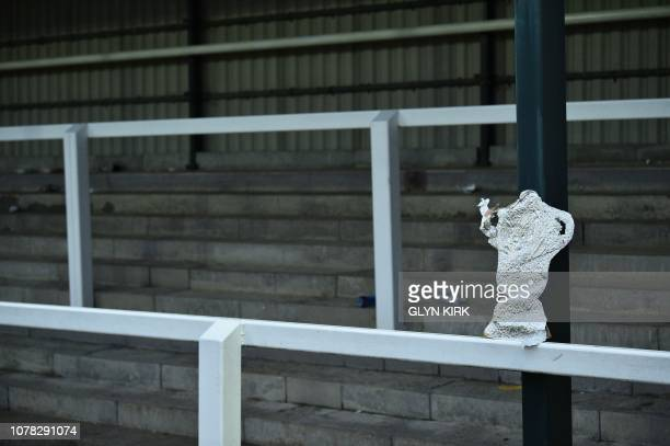 A homemade FA Cup is seen left behind in the empty stands at the end of the English FA Cup third round football match between Woking and Watford at...